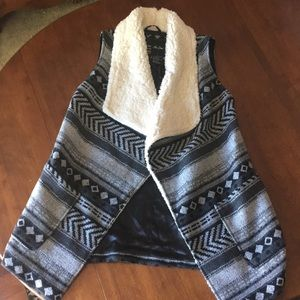 Tribal print wool and shearling vest